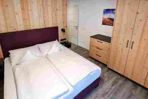 Schlafzimmer der Wohnung Alpenrose im Bayerischen Hof Oberstaufen, Löwen Suites
