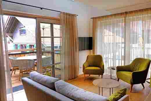 Wohnzimmer im Penthouse Nr. 9 , Ferienwohnung im Bayerischen Hof in Oberstaufen